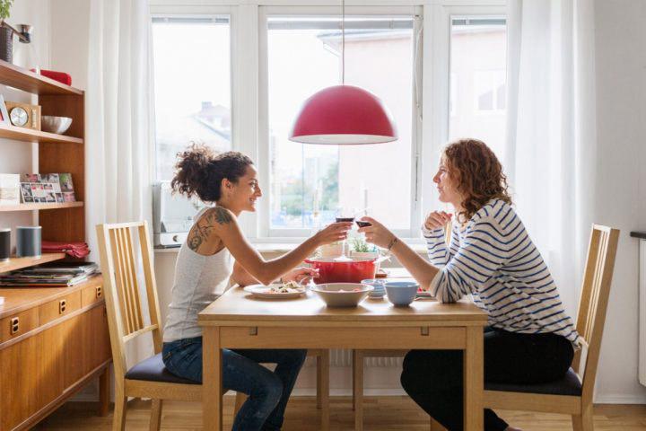 Two women eating dinner – Astrakan Images
